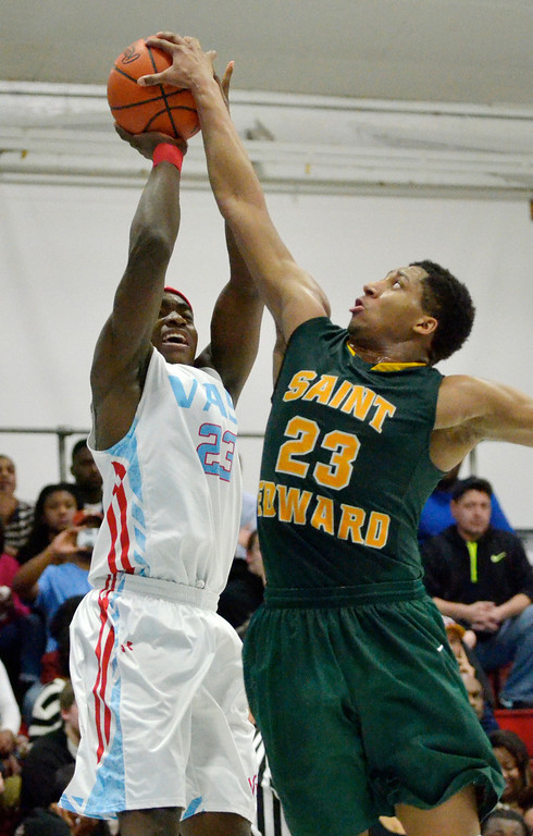Description of . Jeff Forman/JForman@News-Herald.com Marsalis Hamilton, St. Edward, blocks a shot by Deandre Forte, VASJ, in the second quarter of the Vikings' 82-76 loss Feb. 20 at Villa Angela-St. Joseph High School.