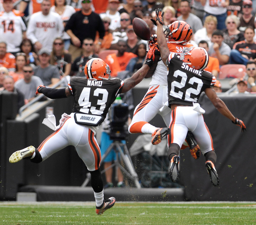 . Jeff Forman/JForman@News-Herald.com Pass interference is called against the Browns as T.J. Ward and Buster Skrine try to break up a passto ohamed Sanu in the first quarter.