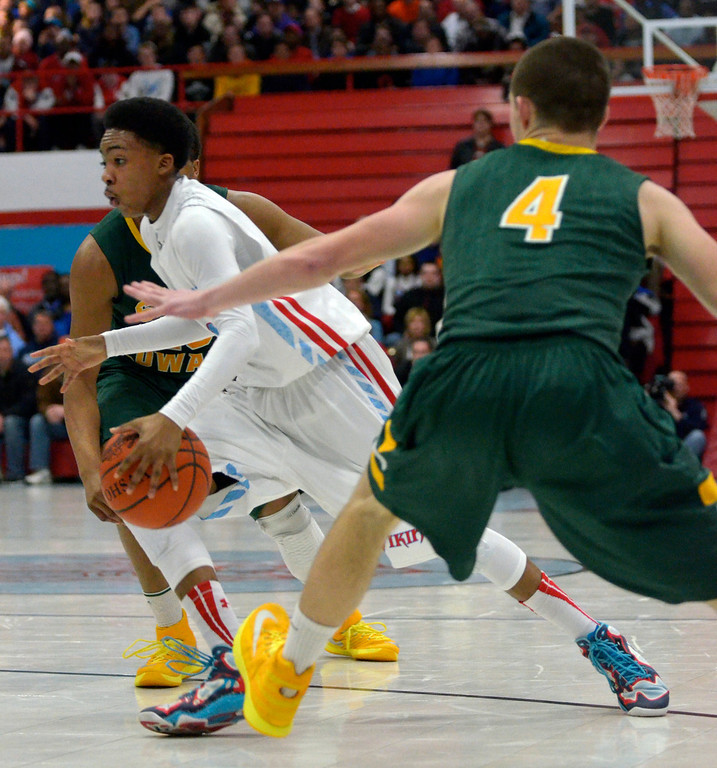 . Jeff Forman/JForman@News-Herald.com Maurice Johnson takes the ball down court against the Eagles during the first half of the Vikings\' 82-76 loss Feb. 20 at Villa Angela -St. Joseph High School.