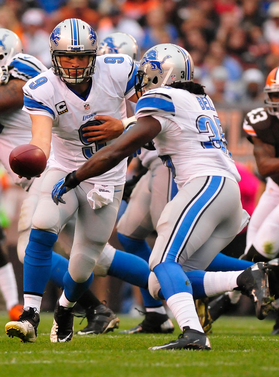 . Sam Greene/The Morning Journal Lions quarterback Matthew Stafford (9) hands off to run inn back running back Joique Bell (35) during the first quarter of the NFL week six game between the Cleveland Browns and Detroit Lions at FirstEnergy Stadium in Cleveland, Ohio, on Sunday, Oct. 13, 2013. Stafford threw for 248 yards against the Browns in the 31-17 Lions victory.