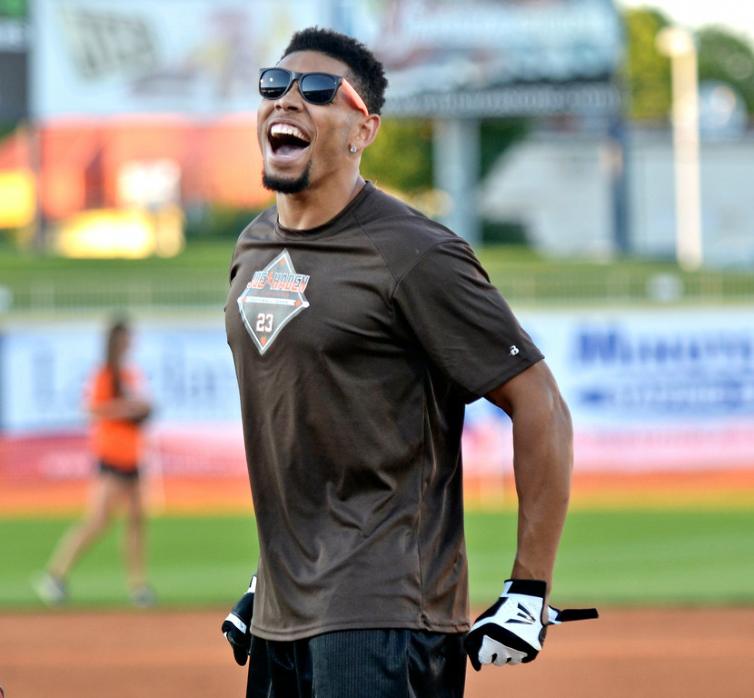 . Jeff Forman/JForman@News-Herald.com Joe Haden celebrates his single during the Joe Haden and Friends Softball Game July 17 at Classic Park in Eastlake.