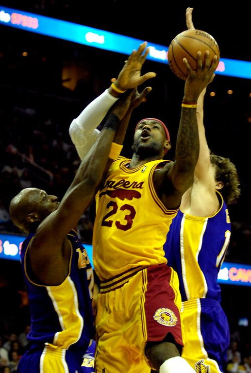 . Jeff Forman/JForman@News-Herald.com LeBron James shoots over Lamar Odom, Lakers, during the first half Sunday at Quicken Loans Arena.