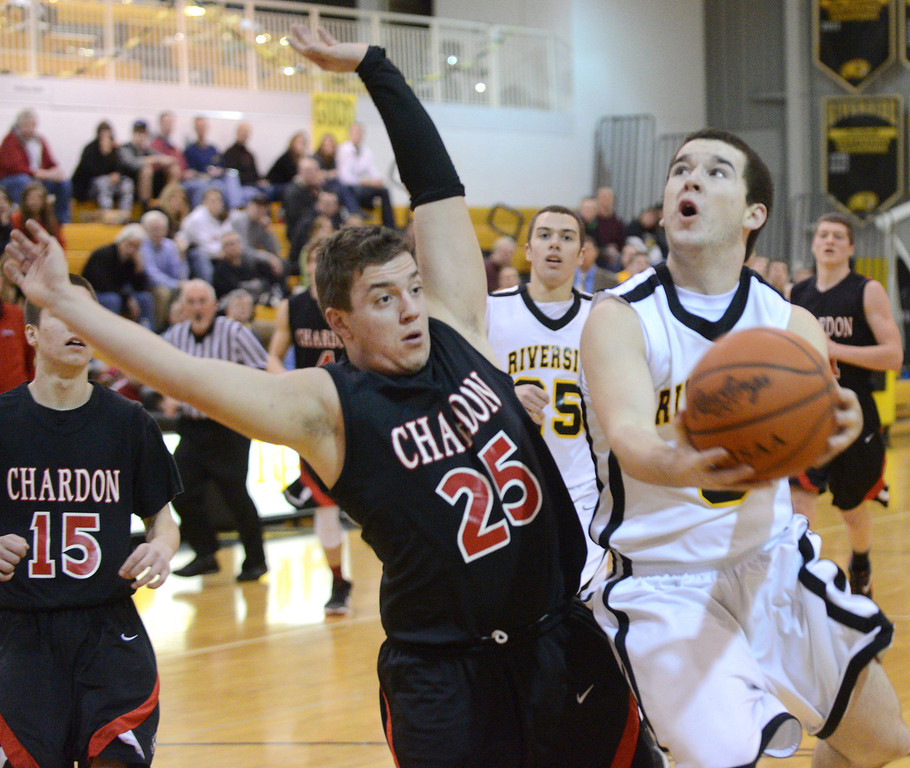 . Duncan Scott/DScott@News-Herald.com Riverside\'s Alex Wade is fouled by Chardon\'s Joe Connick as he shoots in the first quarter. Riverside won Friday\'s PAC matchup 49-43 at the Riverside Community Field House.