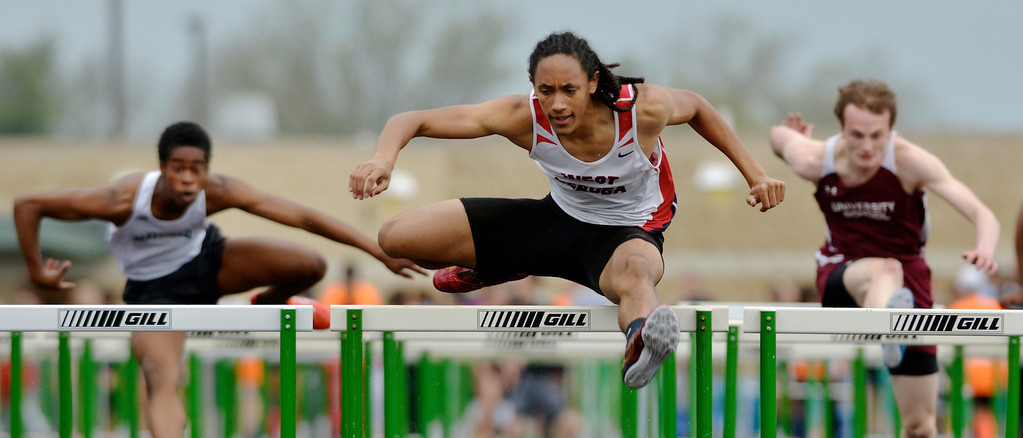 . Jeff Forman/JForman@News-Herald.com Paedyn Gomes, West Geauga, wins the the 100 meter hurdles during the Mayfield 2014 Track and Field Invitaional May 9 at Mayfield High School.