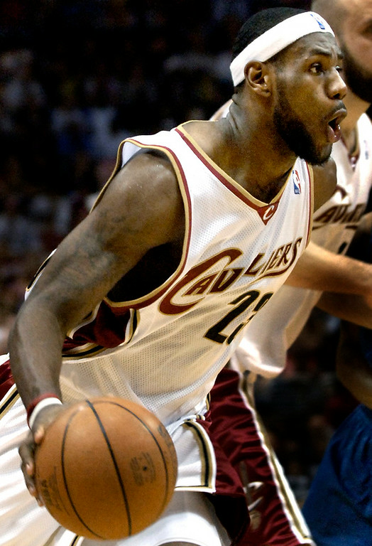 . Jeff Forman/JForman@News-Herald.com LeBron James keeps up the intensity as he drives against the Wizards Saturday during the Cavs\' win in the opening game of the first round playoff series.