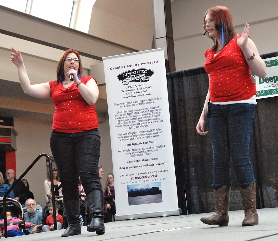 """. Jeff Forman/JForman@News-Herald.com Christina Putman and Kirsten Morcaski sing \""""Take a Hint\"""" at the Deepwood Idol Show March 29 at the Great Lakes Mall. The show was presented by the Lake County Board of Developmental Disabilities/Deepwood."""
