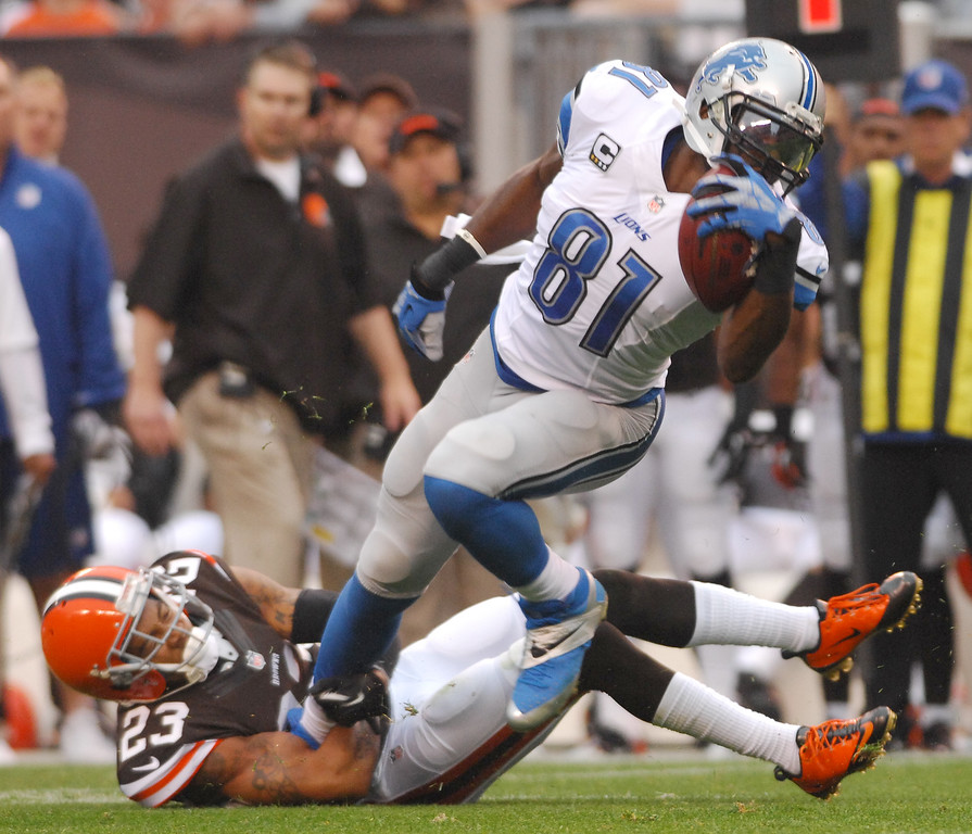 . Michael Allen Blair/MBlair@21st-CenturyMedia.com Browns\' defensive back Joe Haden tackles the Lions\' Calvin Johnson after a short gain during the first quarter versus the Lions at FirstEnergy Stadium in Cleveland, OH. on Sunday, October 13, 2013.