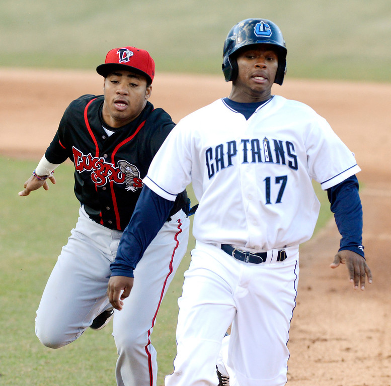 . Maribeth Joeright/MJoeright@News-Herald.com Lake County Captains\' Dorssys Paulino is picked off by Lansing Lugnuts short stop Dawel Lugo in the first inning of the Captains home opener at Classic Park, April 4, 2014.