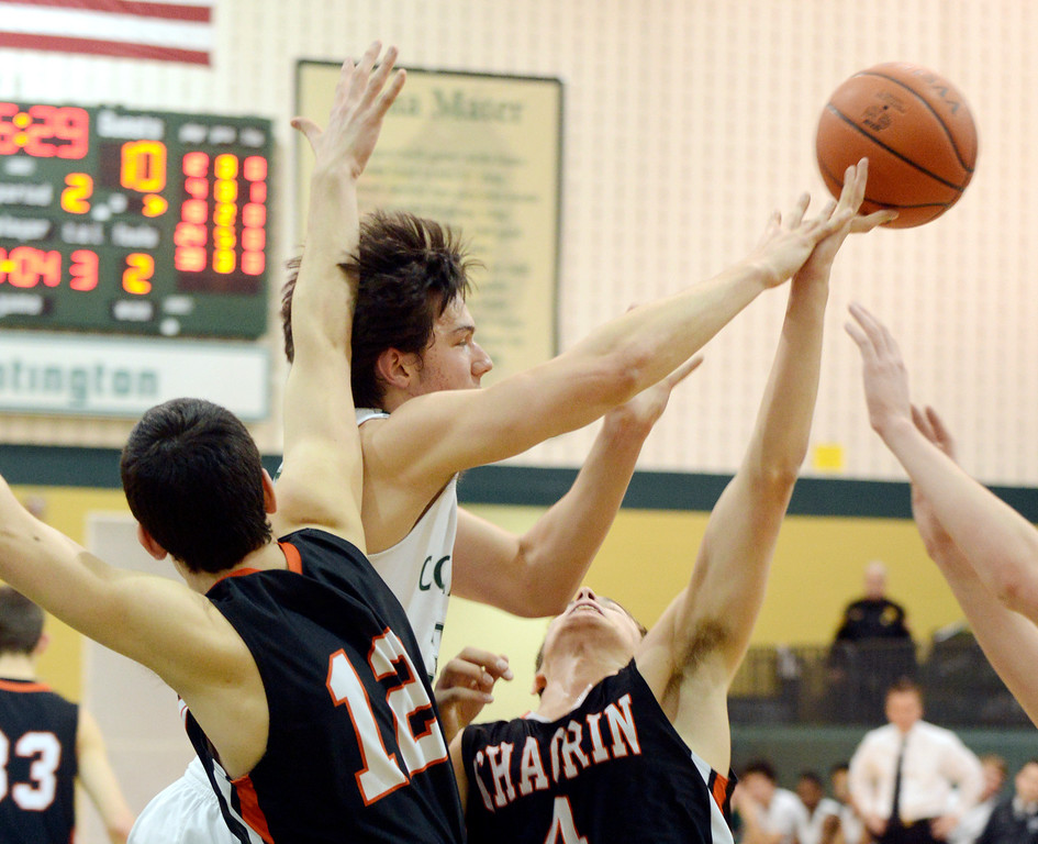 . Maribeth Joeright/MJoeright@News-Herald.com<p> Chagrin\'s Cam Powers, left, and Patrick Donley attempt to block a pass by Lake Catholic\'s Brett Nalepa during the second quarter of the Division II district final game at Lakeside High School, March 8, 2014.