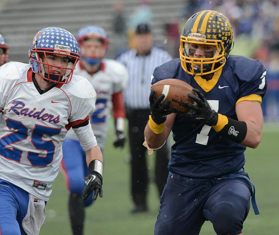 . Duncan Scott/DScott@News-Herald.com Kirtland\'s Matthew Finkler grabs a long touchdown pass in the third quarter of the Division VI state championship game at Fawcett Stadium in Canton. Defending on the play is Jake Arend.