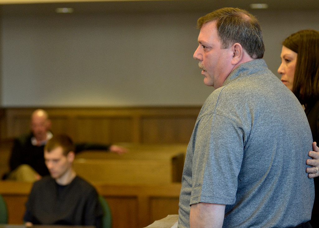 . Jeff Forman/JForman@News-Herald.com Fred Putzbach, right, makes a statement in Lake County Common Pleas Court March 3 before Nathaniel Brown, left, is re-sentenced for the 2011 murder of Putzbach\'s son, William Andrew Fayne Putzbach. Standing with Putzbach is Lake County victim\'s advocate Michelle Corello.
