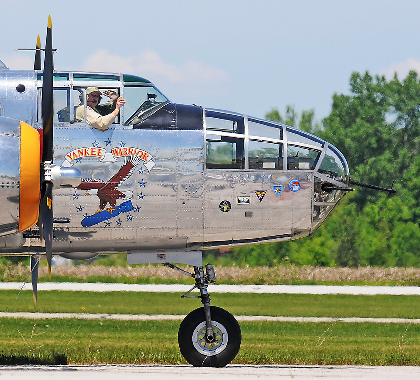 . Jim Bobel/JBobel@MorningJournal.com The B-25 World War II Bomber Yankee Warrior pilot waves to the crowd has he taxies to the runway Discover Aviation Air Show at the Lorain County Regional Airport.