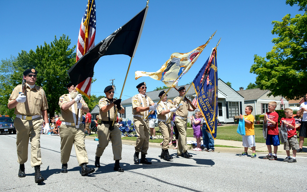 . Jeff Forman/JForman@News-Herald.com The Veterans of Foreign Wars Mentor Post 9295 color guard marches in the Mentor Headlands July 4th Parade.