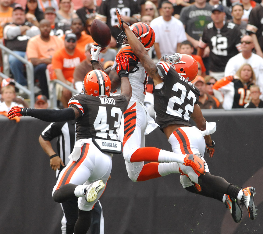 . Michael Allen Blair/MBlair@21st-CenturyMedia.com Browns\' defensive backs T.J. Ward and Buster Skrine break up a pass intended for Bengals\' Mohamed Sanu versus the Bengals at FirstEnergy Stadium in Cleveland, OH. on Sunday, September 29, 2013. Skrine was called for pass interference on the play.