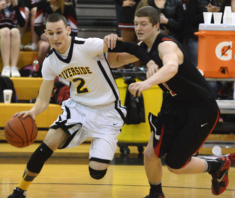 . Duncan Scott/DScott@News-Herald.com Riverside\'s drives to the basket in the first quarter defended by Chardon\'s Drew McCartney. Riverside won Friday\'s PAC matchup 49-43 at the Riverside Community Field House.