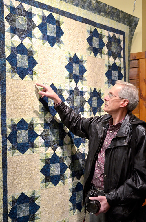 """. Jeff Forman/JForman@News-Herald.com Ron Sieloff, of Chardon, talks about his quilt \""""Weathervane Wonder\"""" during the opening reception for the Quilts 2014 show Thursday at Lake Metoparks Farmpark."""