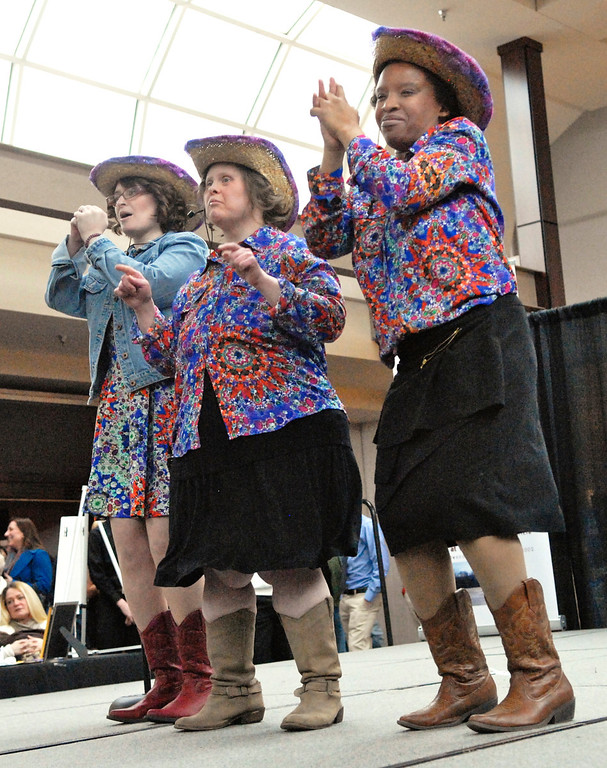 """. Jeff Forman/JForman@News-Herald.com Jessica McAndrews, left, Canesia King and Susan Murphy sing \""""Boys \'Round Here\"""" at the Deepwood Idol Show March 29 at the Great Lakes Mall. The show was presented by the Lake County Board of Developmental Disabilities/Deepwood."""