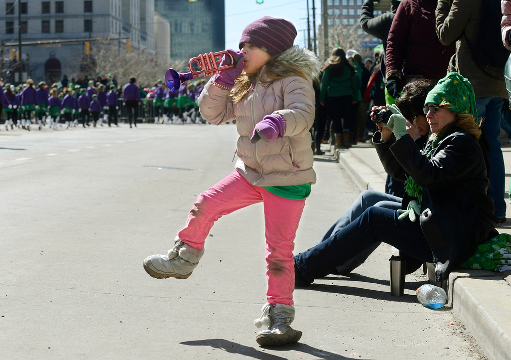 . Maribeth Joeright/MJoeright@News-Herald.com<p> Emma Rudowsky, 6, of Avon plays her own miniature trumpet as marching bands pass by during the 147th annual St. Patrick\'s Day parade in Cleveland, March 17, 2014. Emma was with her mother Julie and her baby sister Anna.