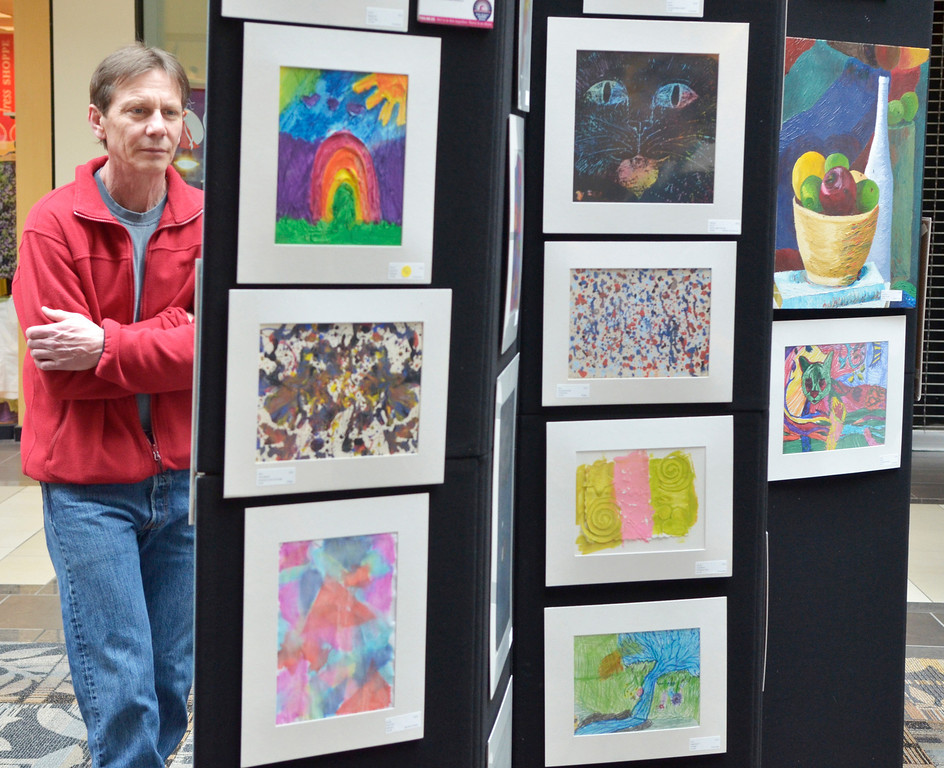". Jeff Forman/JForman@News-Herald.com Ken Irons looks at work on display in the ""Expressions of Recovery\"" exhibit at the Great Lakes Mall. The show is sponsored by the Lake County ADAMHS Board."
