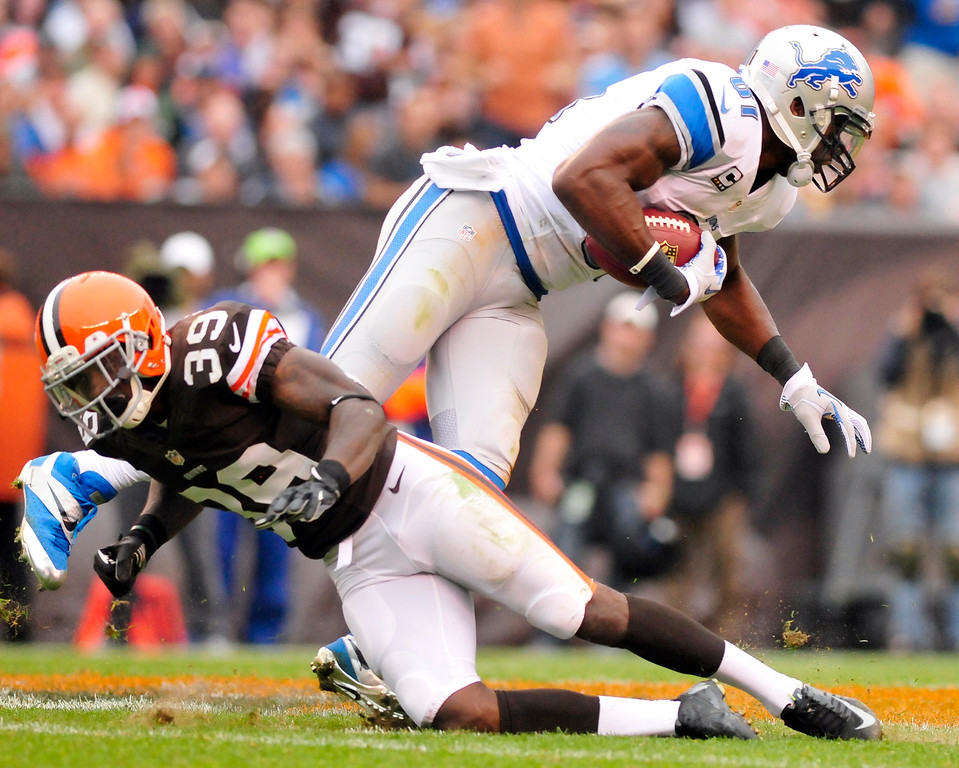 . Sam Greene/The Morning Journal Lions wide receiver Calvin Johnson (81) dodges a tackle attempt by Browns defensive back Tashaun Gipson during the third  quarter of the NFL week six game between the Cleveland Browns and Detroit Lions at FirstEnergy Stadium in Cleveland, Ohio, on Sunday, Oct. 13, 2013. John tallied 25 yards on 3 catches against the Browns.