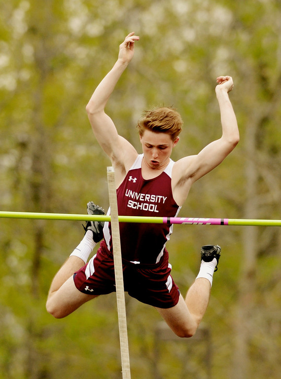 . Jeff Forman/JForman@News-Herald.com University School pole vaulter Jack McGee clears 12-6 during the Mayfield 2014 Track and Field Invitaional May 9 at Mayfield High School.