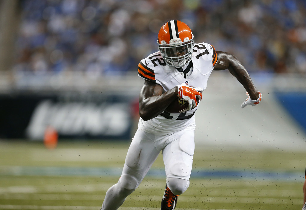 . Cleveland Browns wide receiver Josh Gordon (12) runs with the ball against the Detroit Lions in the first half of a preseason NFL football game at Ford Field in Detroit, Saturday, Aug. 9, 2014.  (AP Photo/Rick Osentoski)