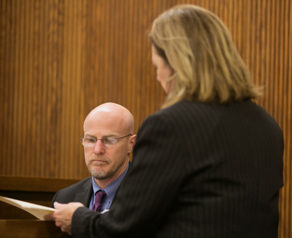 . Michael Allen Blair/MBlair@News-Herald.com Prosecutor Karen Kowall reviews finacial records with witness John Wooley, a district manager for Chase Bank on day three of Kevin Knoefel\'s murder conspiracy trial in Lake County Common Pleas Court on June 4, 2014.