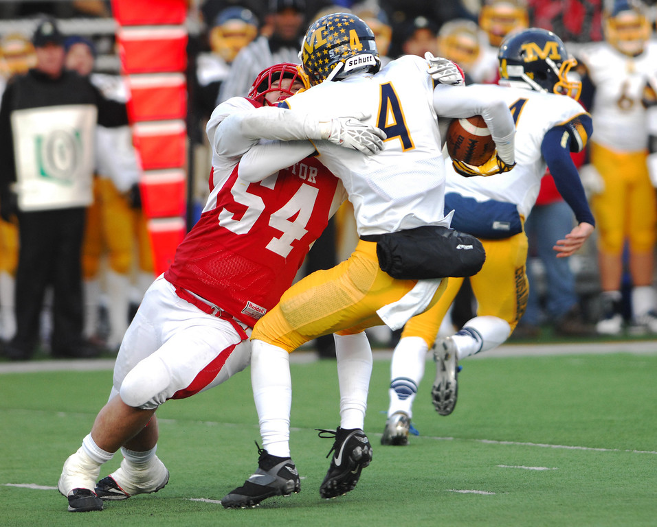 . Michael Allen Blair/ MBlair@News-Herald.com Cincinnati Moeller wide receiver Chase Pankey is tackled for a loss on a reverse attempt by Mentor\'s Nico Lautanen during the second quarter of Saturday\'s Div. I state championship game at Fawcett Stadium in Canton.