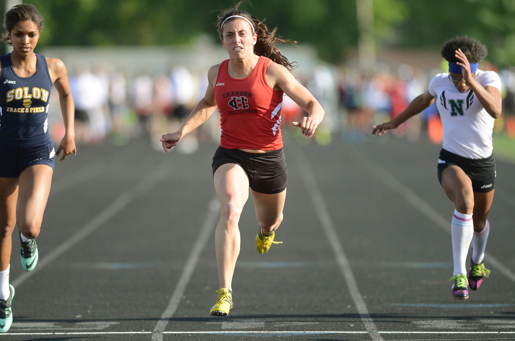 . Maribeth Joeright/MJoeright@News-Herald.com<p> Chardon\'s Stephanie Ferrante reaches for the finish line in the girls 100 meter dash during the Division I regional finals at Austintown Fitch High School, May 23, 2014. Ferrante took second place in the event.