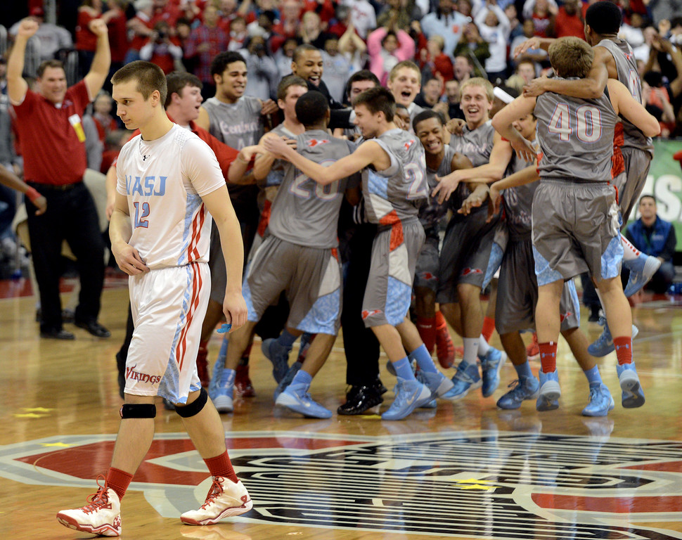 . Duncan Scott/DScott@News-Herald.com VASJ\'s Jeff Grudzinski leaves the court as Lima Central Catholic celebrates their 64-62 win in the Division III state championship game on March 22 in the Value City Arena in the Jerome Schottenstein Center in Columbus.