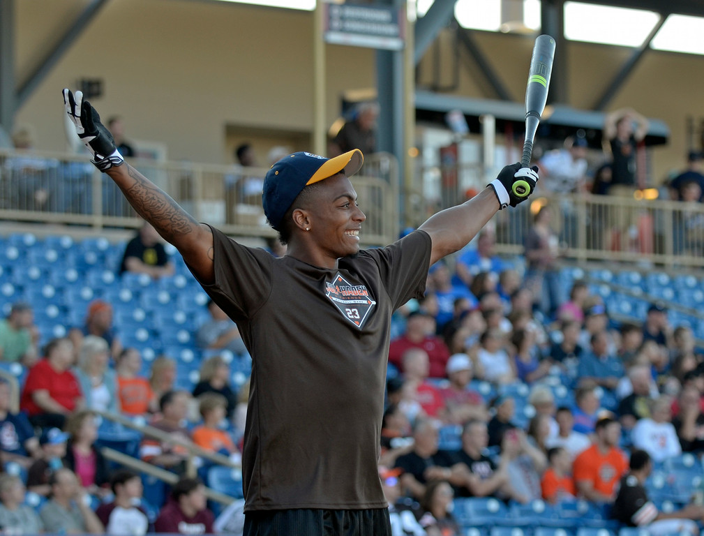 . Jeff Forman/JForman@News-Herald.com Buster Skrine celebrates a home run during the derby before the Joe Haden and Friends Softball Game July 17 at Classic Park.