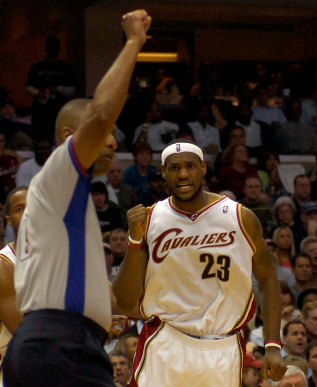 . PHOTO BY DAVID RICHARD LeBron James pumps his fist as a foul is called after James made a layup in traffic yesterday against Washington.