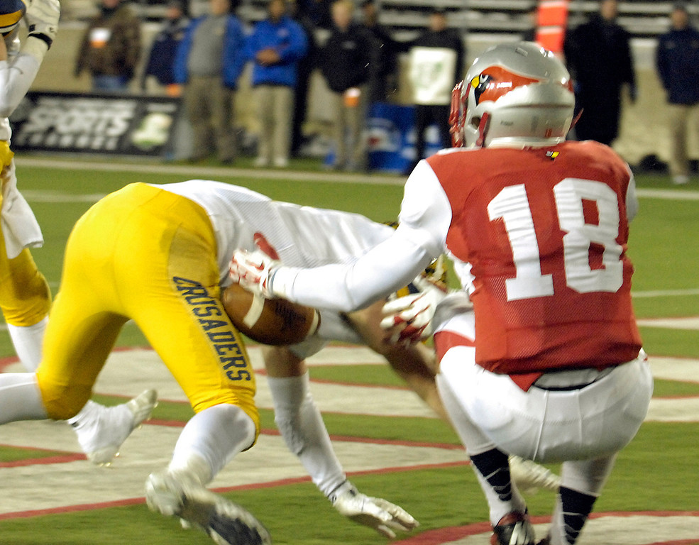 . Maribeth Joeright/MJoeright@News-Herald.com <p> Mentor\'s Jake Berardinelli is hit by Moeller\'s Mitch Brauning in the end zone causing Berardinelli to drop the ball in the fourth quarter of the Division I state final game, Saturday, in Canton.