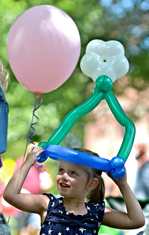 . Jeff Forman/JForman@News-Herald.com Peyton Pruce, 4, wears a balloon crown during the July 4th Old Glory Day celebration on Chardon Square. Peyton was there with her grandmother, Deb Pruce, of Chardon.