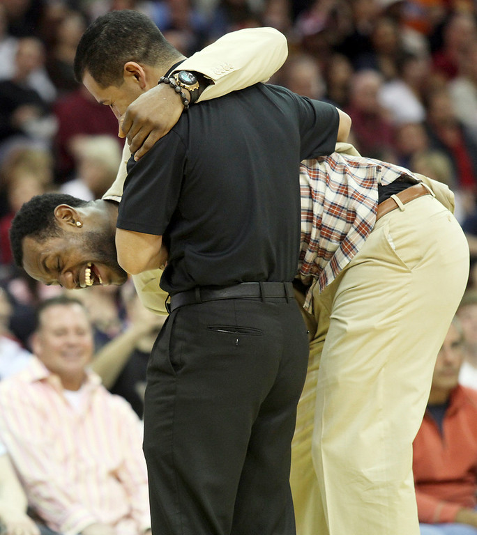 . Michael Allen Blair/MBlair@News-Herald.com LeBron James gets some support from one of the Cavs\' medical team members while having a laugh attack during a timeout of the first half of Sunday\'s game at The Q.
