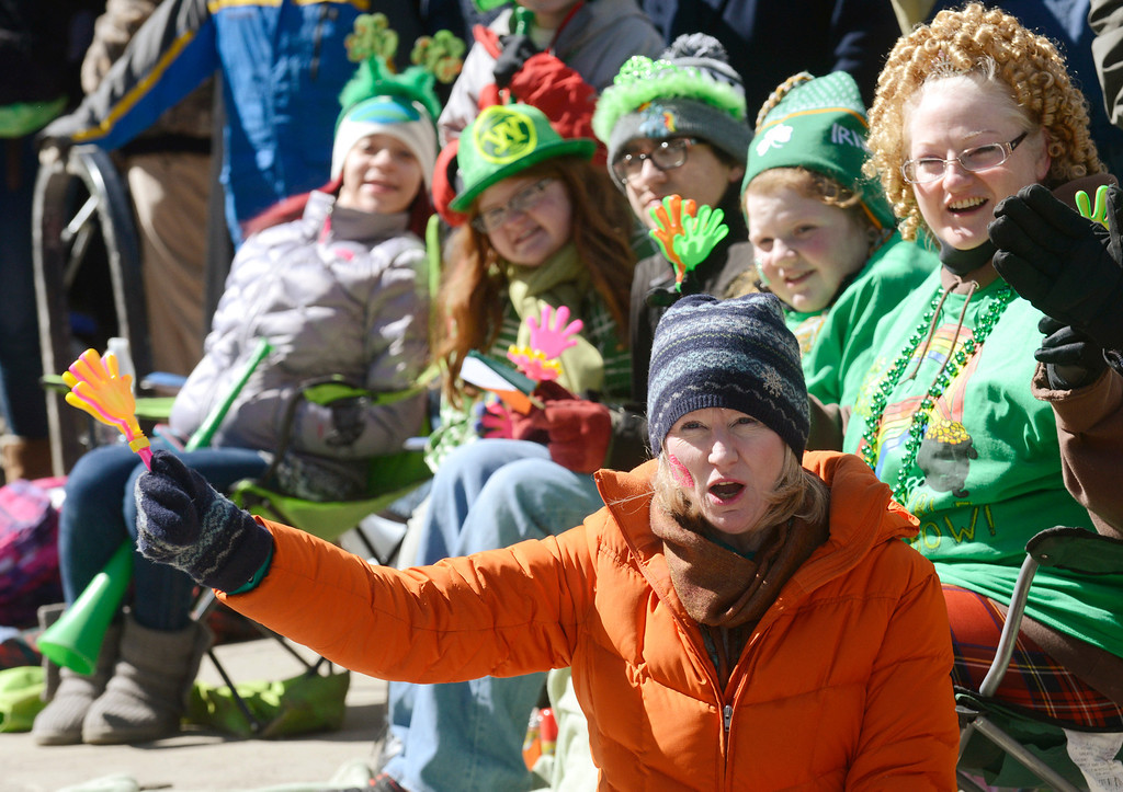 . Maribeth Joeright/MJoeright@News-Herald.com Anne Sombat of Cleveland Heights cheers and waves to participants of the 147th St. Patrick\'s Day parade in Cleveland, March 17, 2014.