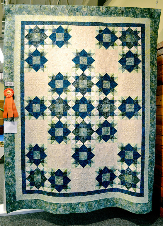 """. Jeff Forman/JForman@News-Herald.com \""""Weathervane Wonder\"""" by Ron Sieloff, of Chardon received an honorable mention in the individual pieced bed quilt category."""