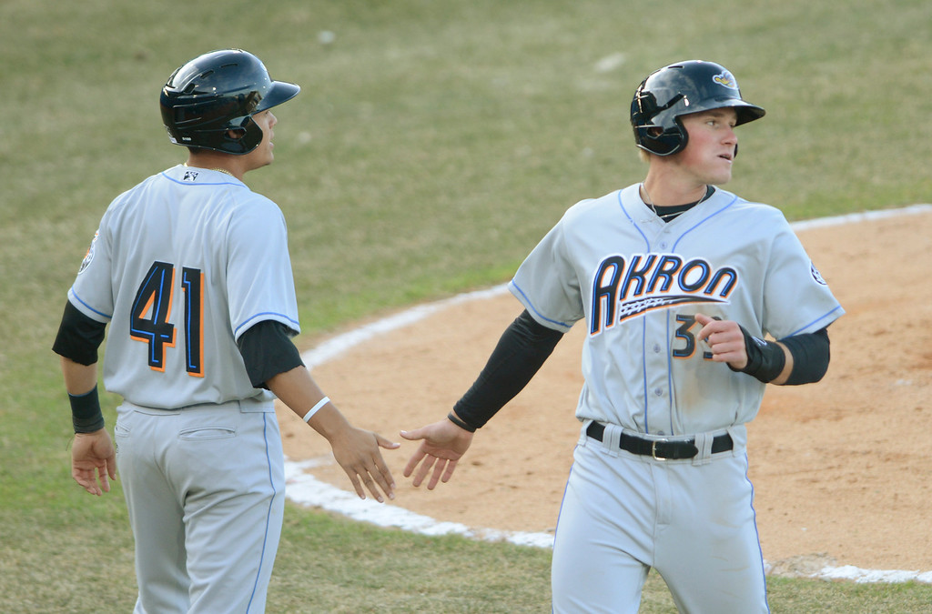 . Maribeth Joeright/MJoeright@News-Herald.com<p> Rubberducks Giovanny Urshela congratulates teammate Jordan Smith at home plate during an exhibition game against the Captains. The Rubberducks scored 11 runs and beat the Captains 11-1.