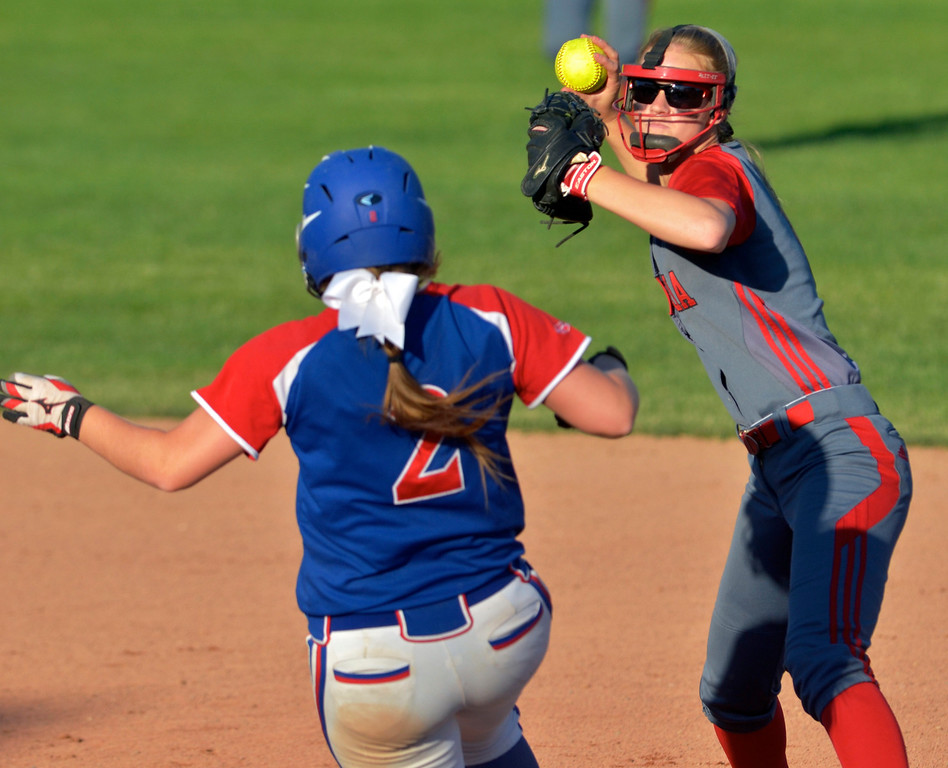 . Jeff Forman/JForman@News-Herald.com Grove City runner Kara Warren is out at second base as Elyria shortstop CArly Bachna tries for a double play in the sixth inning of the Pioneer\'s 9-1 state semi final loss June 5 at Firestone Stadium in Akron.