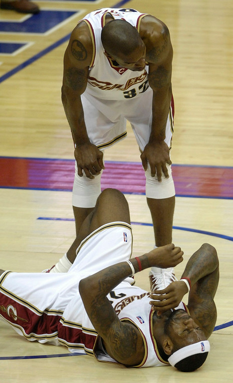 . Michael Blair/MBlair@News-Herald.com Cav\'s Joe Smith leans over LeBron James after a flagrant foul by the Celtic\'s James Posey.
