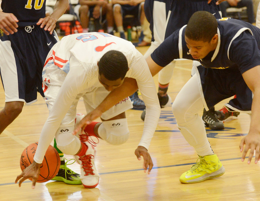 . Maribeth Joeright/MJoeright@News-Herald.com<p>  Villa Angela-St. Joseph\'s Simon Texidor and Warrensville\'s Quinton Wells chase a loose ball during the second quarter of the Division III district chamionship, March 7, 2014.