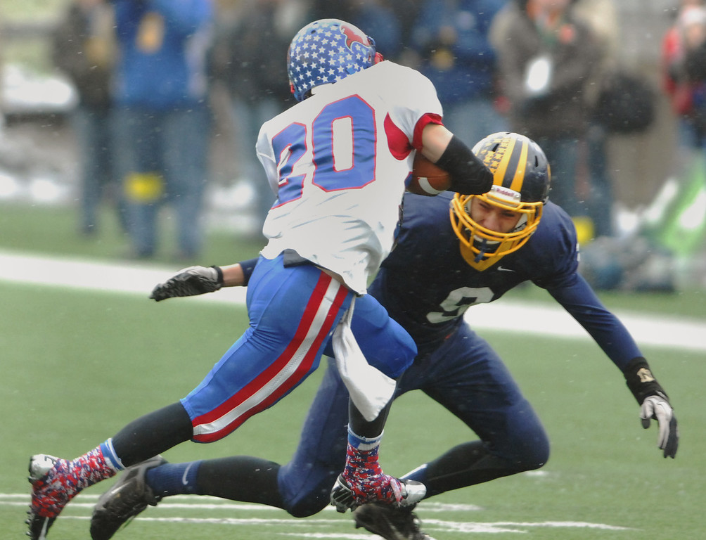 . Michael Allen Blair/ MBlair@News-Herald.com Kirtland linebacker Evan Madden tackles Wayne Trace wide receiver Tyler Showalter during the first quarter of Friday\'s Div VI state championship victory over Wayne Trace at Fawcett Stadium in Canton.