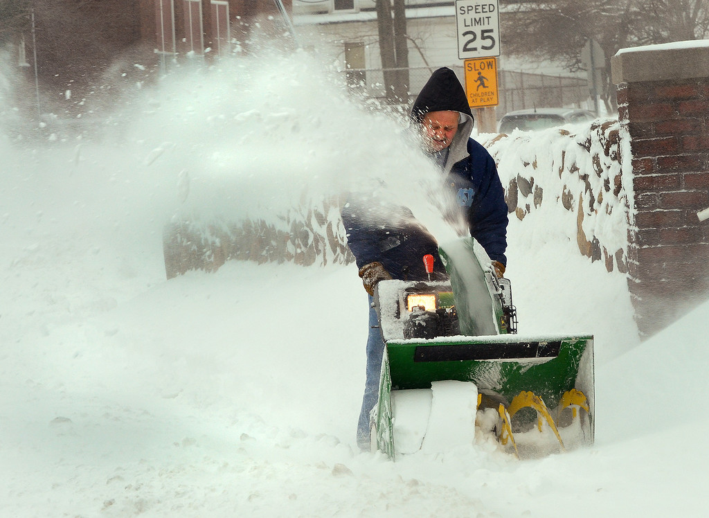 . Michael Allen Blair/MBlair@News-Herald.com Joe Korb, maintenance worker for the Willoughby-Eastlake Technical Center clears snow from the sidewalk in front of the school Wednesday morning on Center Street in Willoughby.