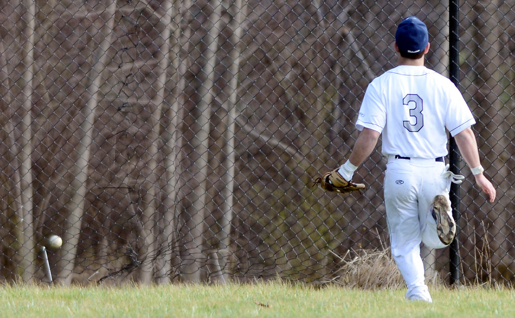 . Maribeth Joeright/MJoeright@News-Herald.com<p> West Geauga outfielder Carmen Engoglia gives chase but this ball hit by Kenston\'s Jake Silberman was gone for a two run home run. Kenston beat West Geauga by a score of 16-3.