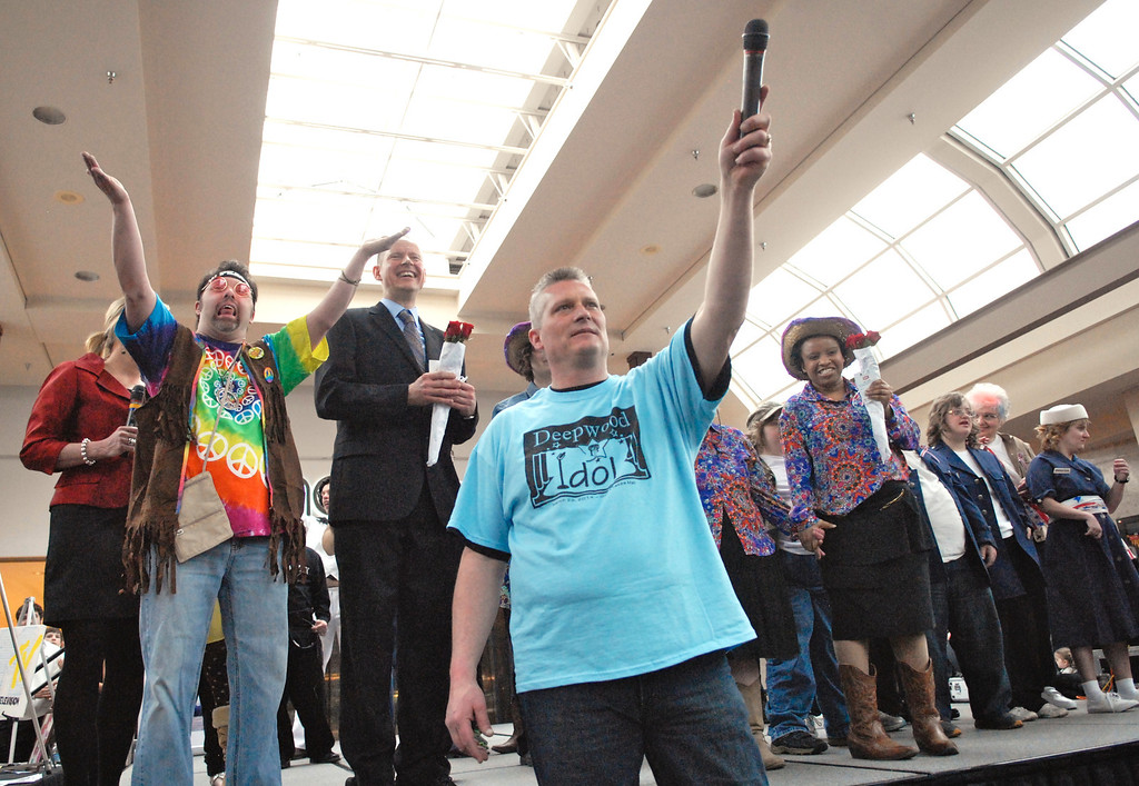 . Jeff Forman/JForman@News-Herald.com Emcee Cameron Zwagerman listens to the aucdience cheers for contestants at the Deepwood Idol Show March 29 at the Great Lakes Mall. The show was presented by the Lake County Board of Developmental Disabilities/Deepwood.