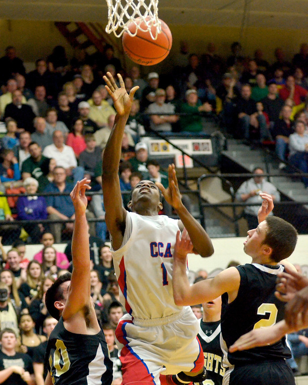 . Jeff Forman/JForman@News-Herald.com Isaiah McQueen shoots for two in the first half of the Patriots\' Division IV Regional semifinal game March 11 against St. Thomas Aquinas.