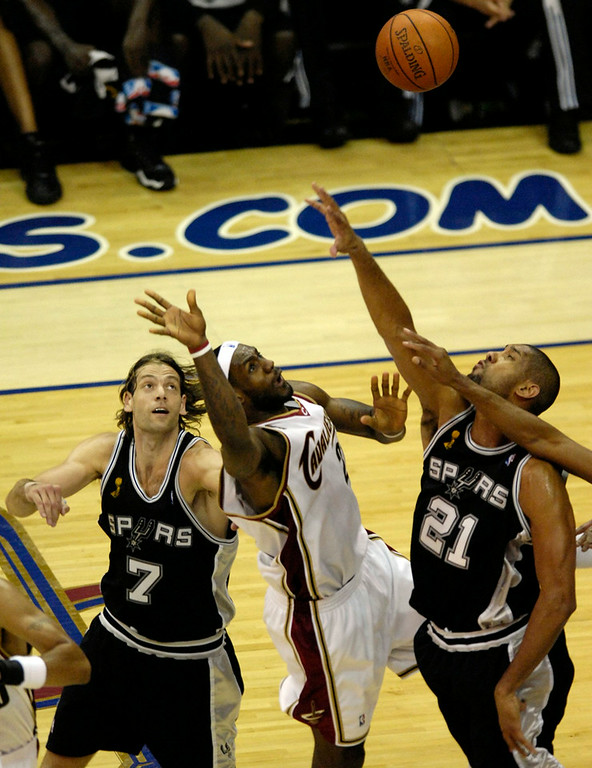 . Michael Blair/MBlair@News-Herald.com The Cavs LeBron Jmaes misses one of several baskets as the Spurs\' Fabricio Oberto, left, and Tim Duncan defend during the fourth quarter of last night\'s loss to the Spurs.