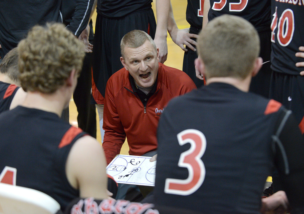. Duncan Scott/DScott@News-Herald.com Chardon\'s coach Doug Snyder urges his team on during a fourth quarter timeout against Riverside. Riverside won Friday\'s PAC matchup 49-43 at the Riverside Community Field House.
