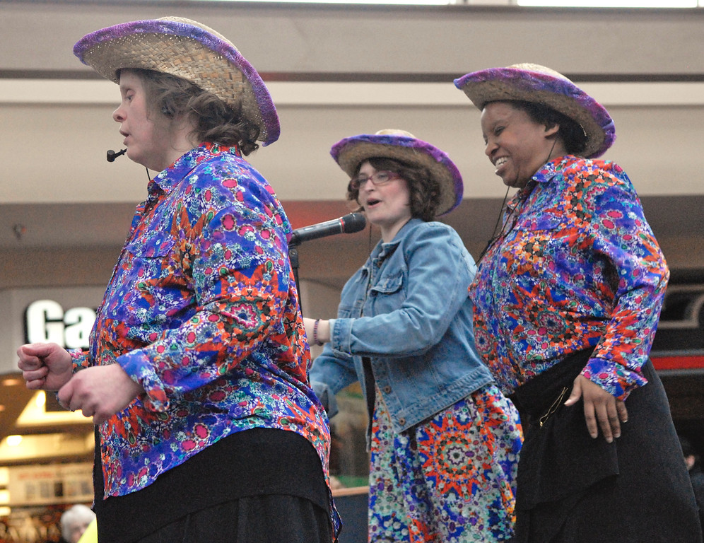 """. Jeff Forman/JForman@News-Herald.com Susan Murphy, left, Jessica McAndrews and Canesia King sing \""""Boys \'Round Here\"""" at the Deepwood Idol Show March 29 at the Great Lakes Mall. The show was presented by the Lake County Board of Developmental Disabilities/Deepwood."""