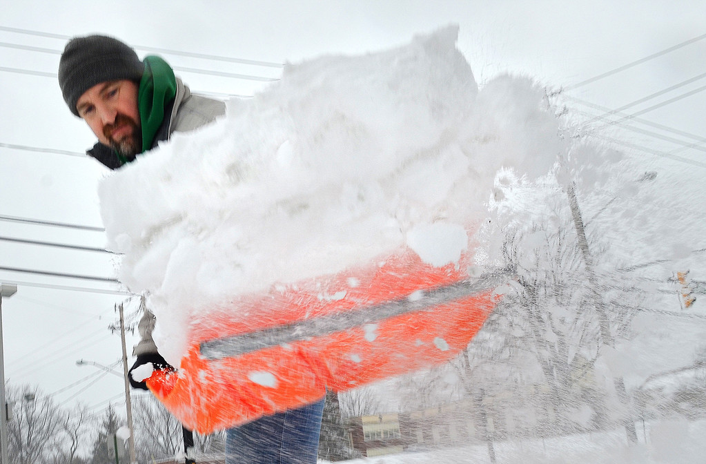 . Michael Allen Blair/MBlair@News-Herald.com Kevin Coyne shovels snow Wednesday in front of McMahon-Coyne-Vitantonio Funeral Homes in Willoughby.